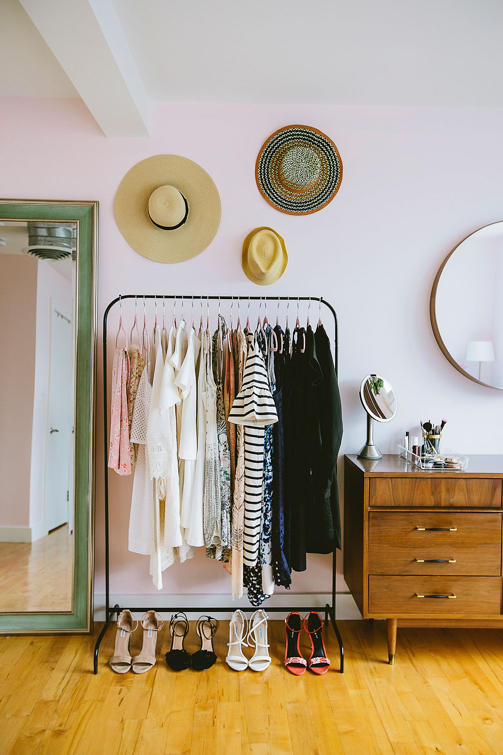 house buying tips: how we bought twice by age 27 - wardrobe rack closet with hat gallery wall