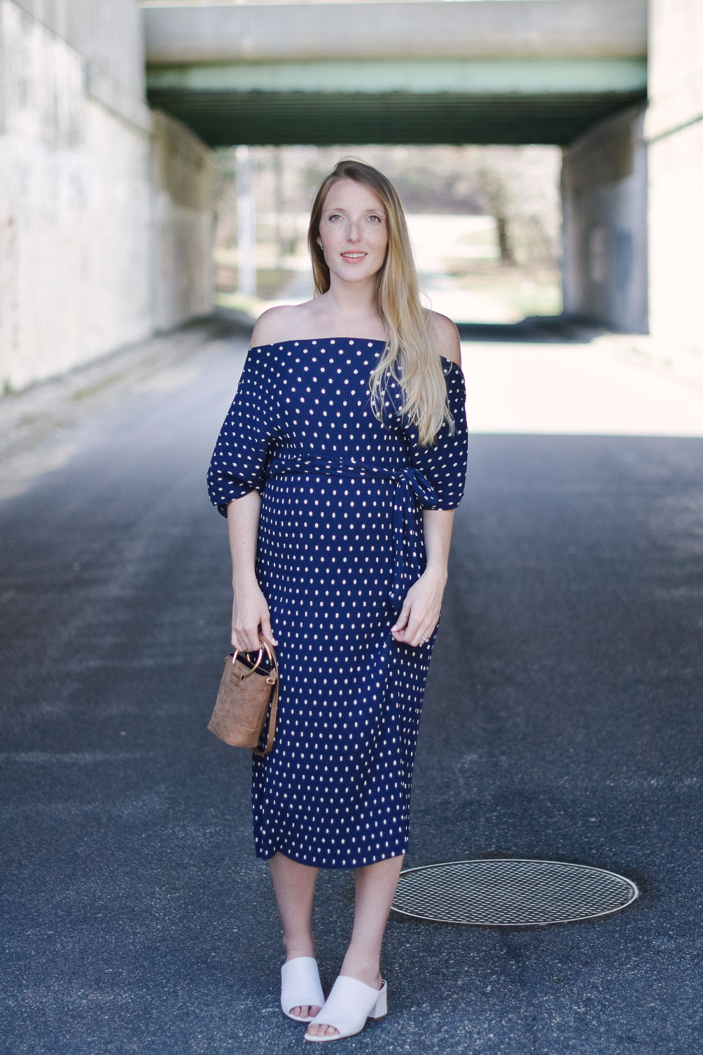 wearing spring maternity style with an off shoulder dress in polka dots