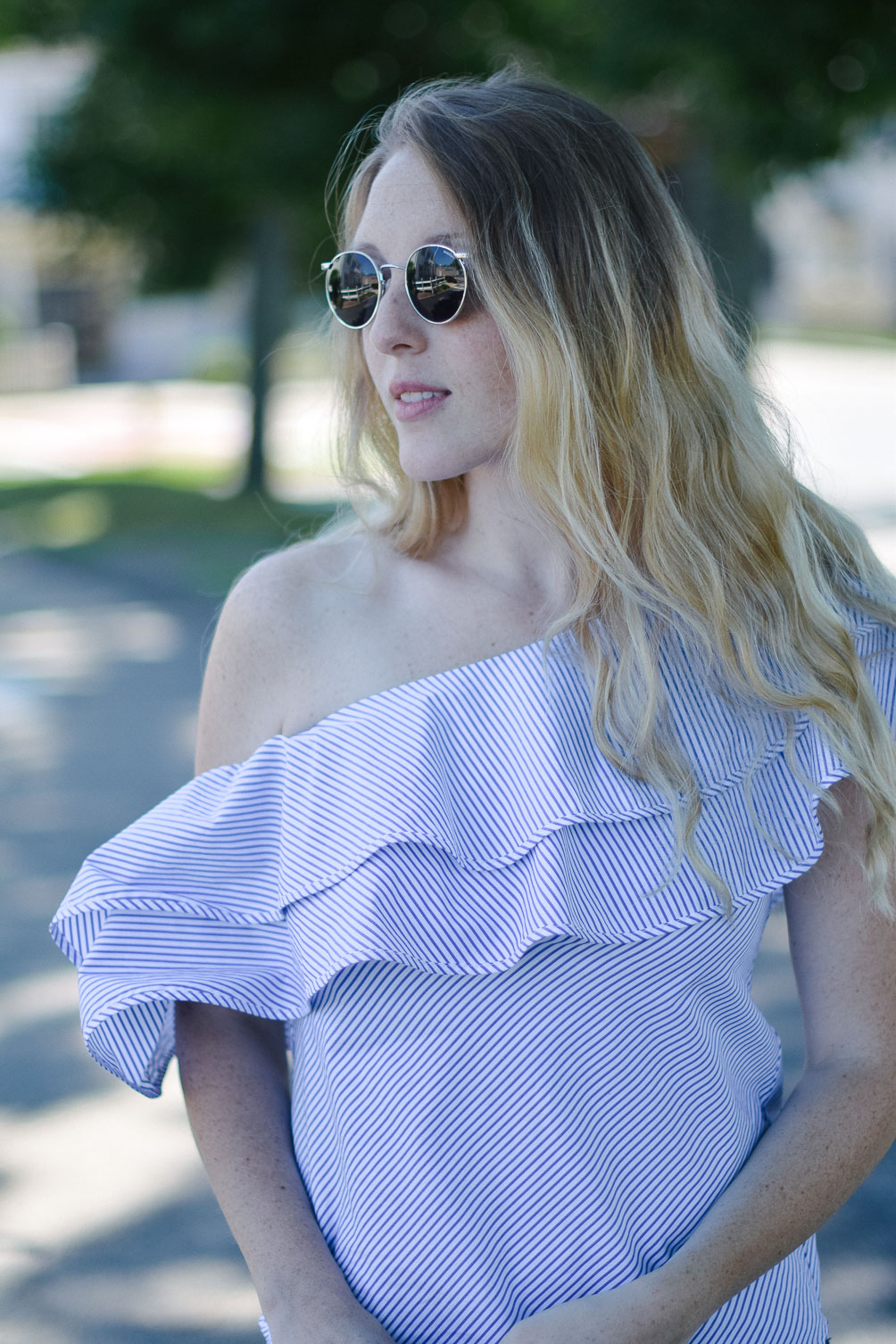styling a summer outfit with this ruffle one shoulder top and round retro sunglasses