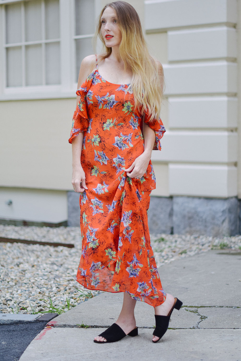 Leslie Musser styling an orange frill maxi dress with circle crossbody and suede mules on one brass fox