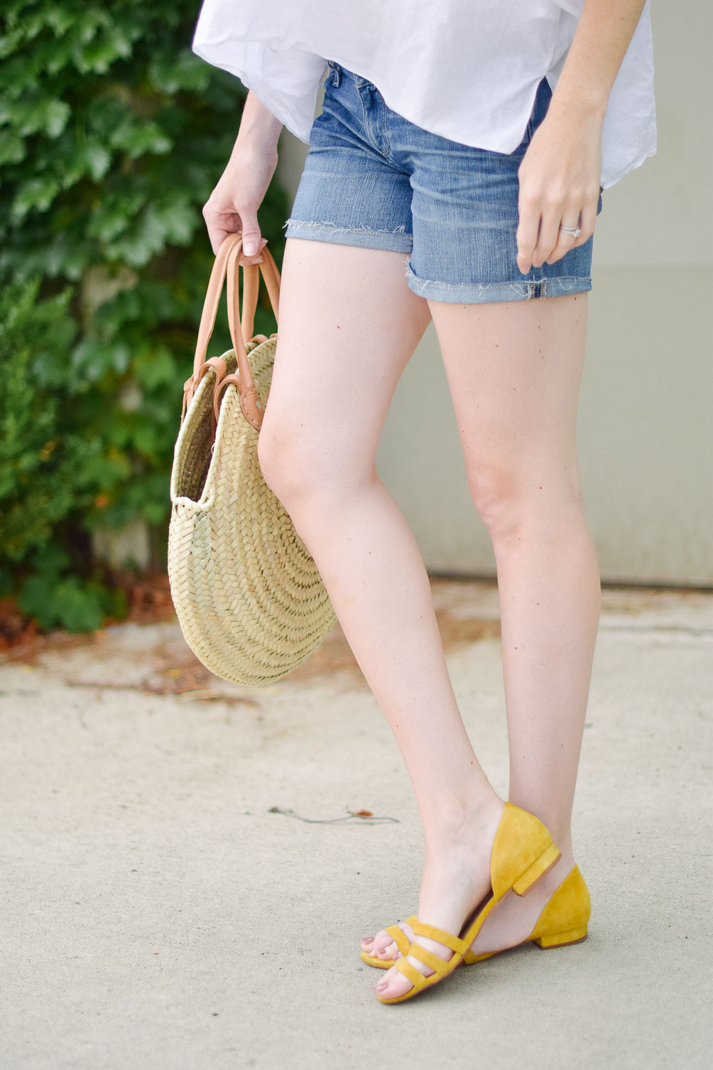 Leslie Musser styling the perfect straw market bag with Paige denim shorts and citron flats