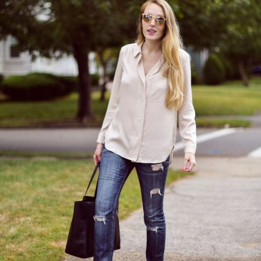 Leslie Musser styling pink fur loafers for fall with distressed skinny jeans, a blush silk top, and black leather tote