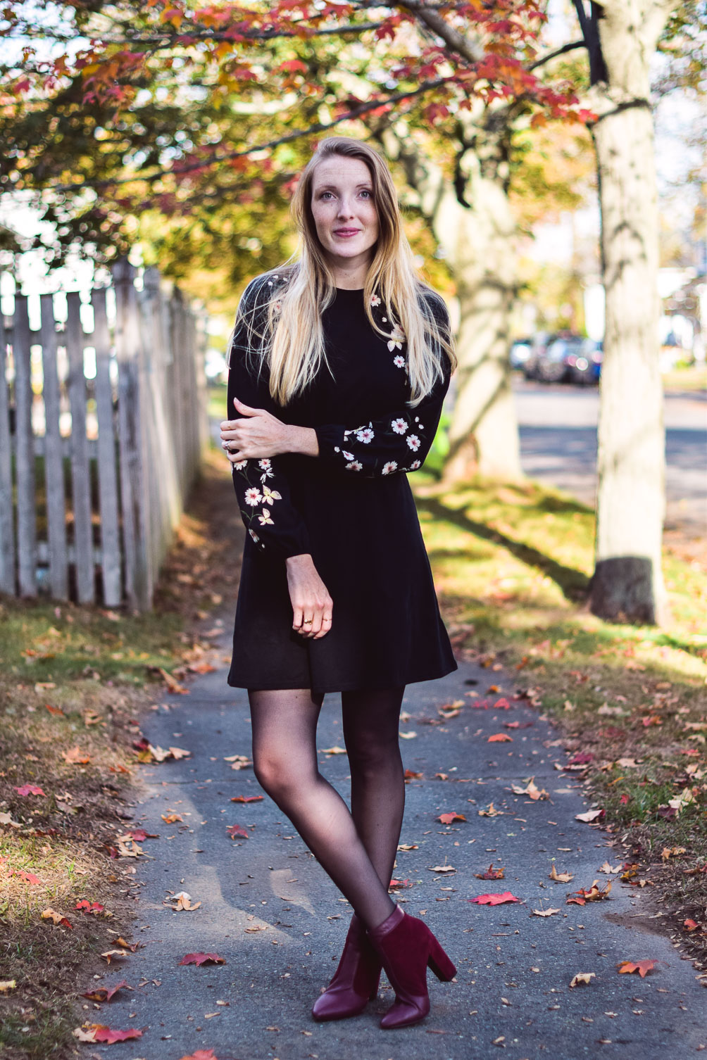sharing an easy holiday party outfit with this Topshop balloon sleeve dress, checked trench coat, and oxblood booties