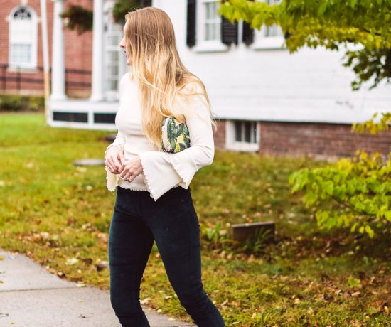 styling deep green velvet pants with a ruffled bell sleeve sweater and faux leather slides for top fall fashion trends
