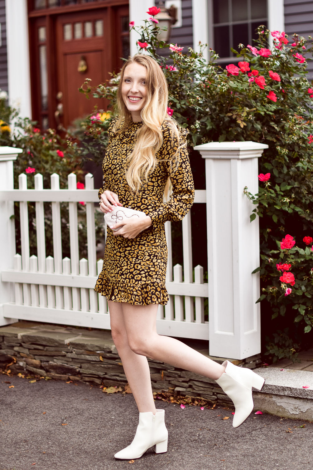 styling a cute fall outfit with this leopard mini dress and white ankle boots