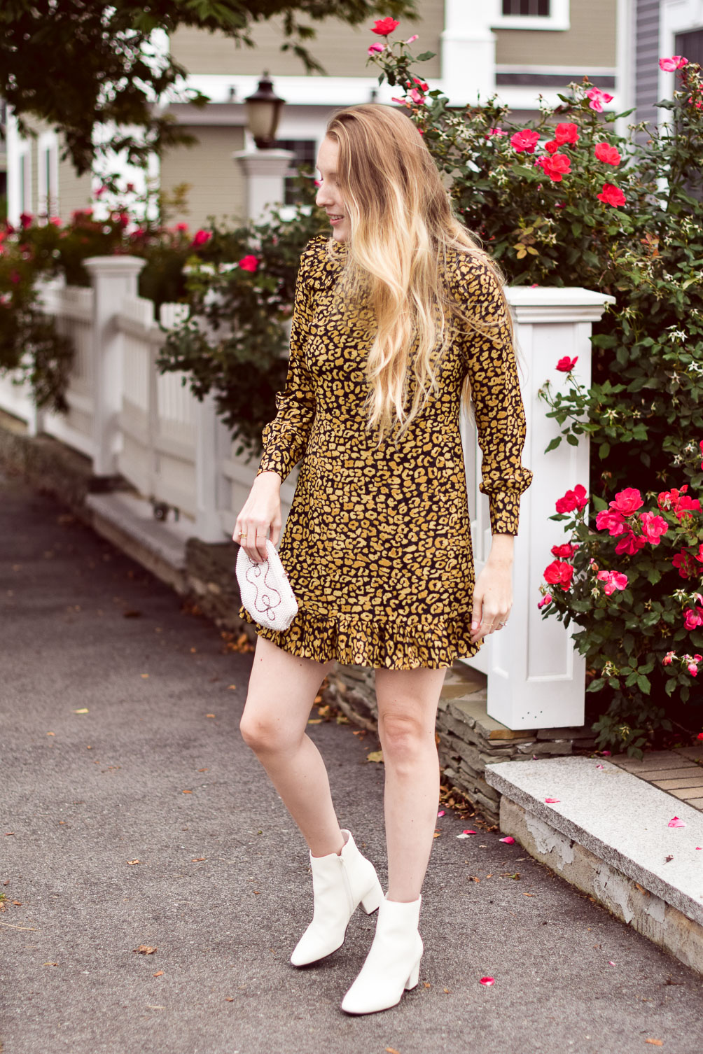 styling a cute fall outfit with this leopard print mini dress and white ankle boots