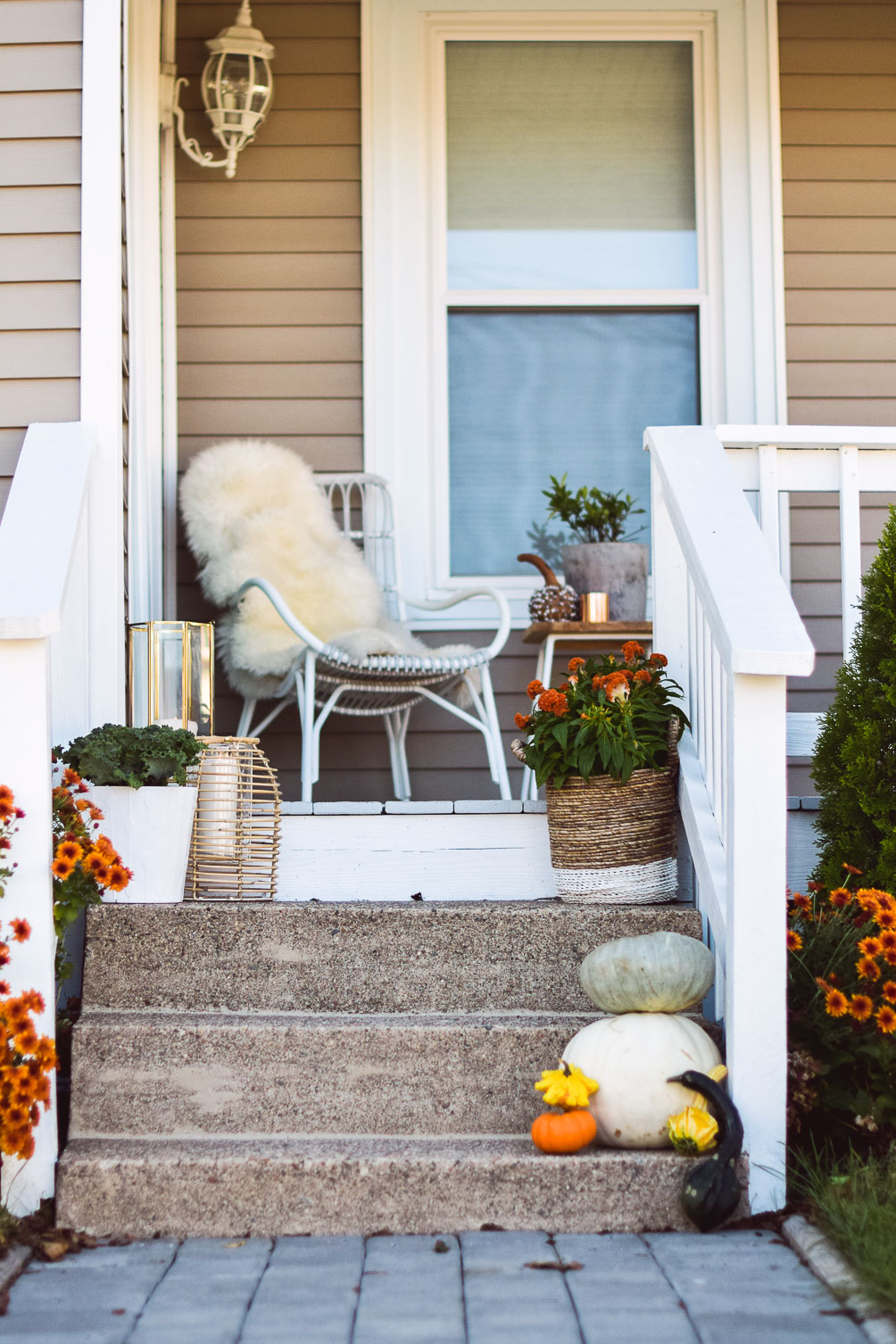 styling a porch with cute and festive outdoor fall decor on a budget