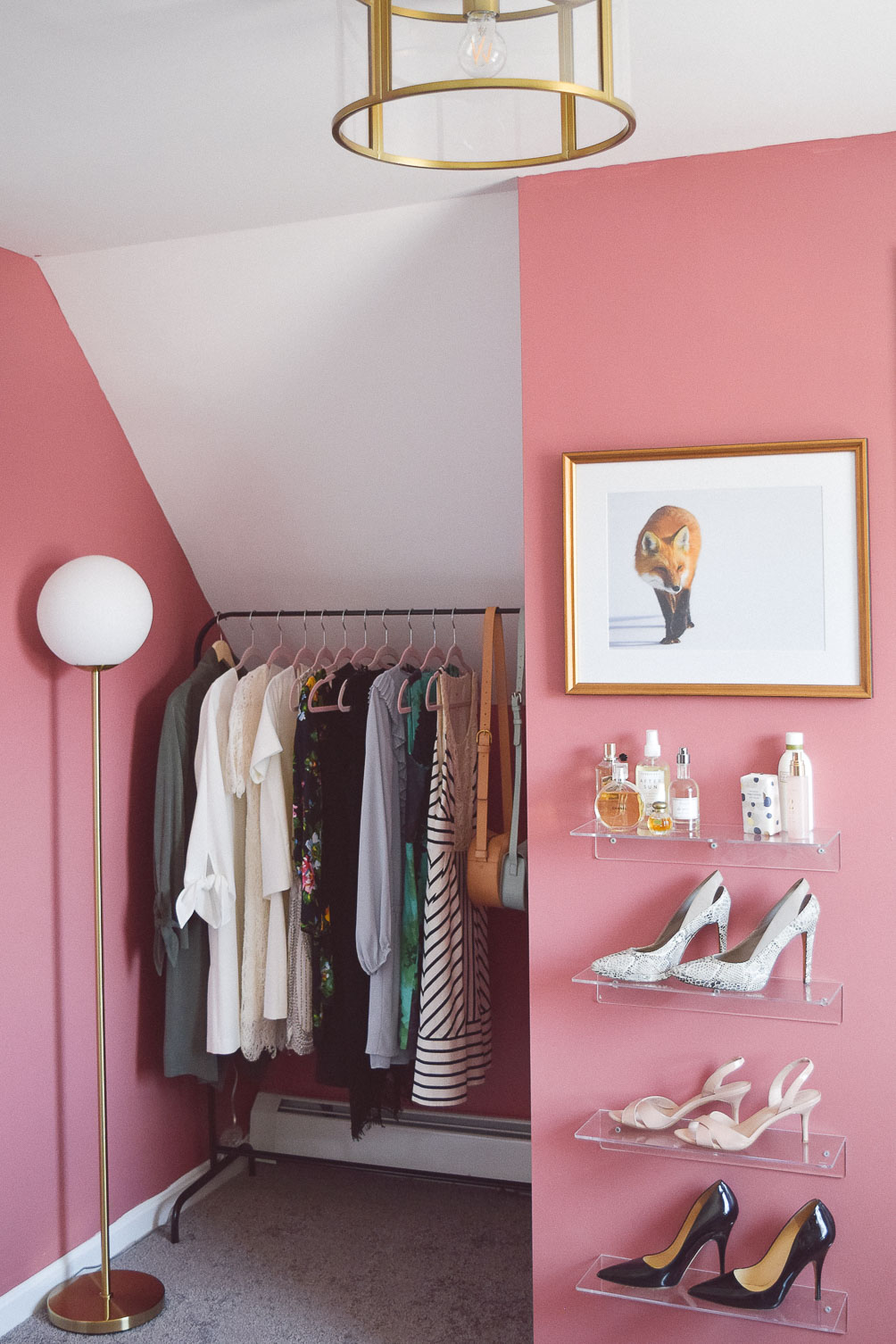 fashion blogger home office tour with garment rack and lucite shoe display