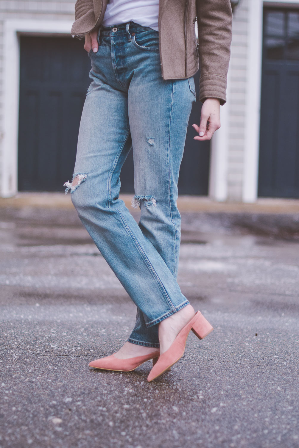 wearing Gap x Cone Denim high rise straight jeans with a shearling collar jacket, graphic tee, and pink block heel mules