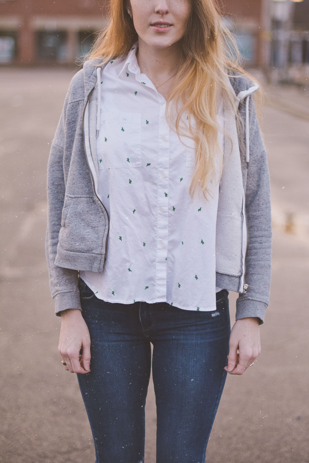 sharing my spring travel style with a gray hoodie, embroidered shirt, destroyed jeans and blush suede mules