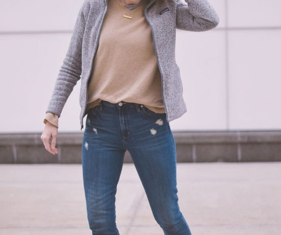 styling neutral layers for an easy, casual, and comfortable spring outfit with this cashmere sweater, raw hem jeans, and white sneakers