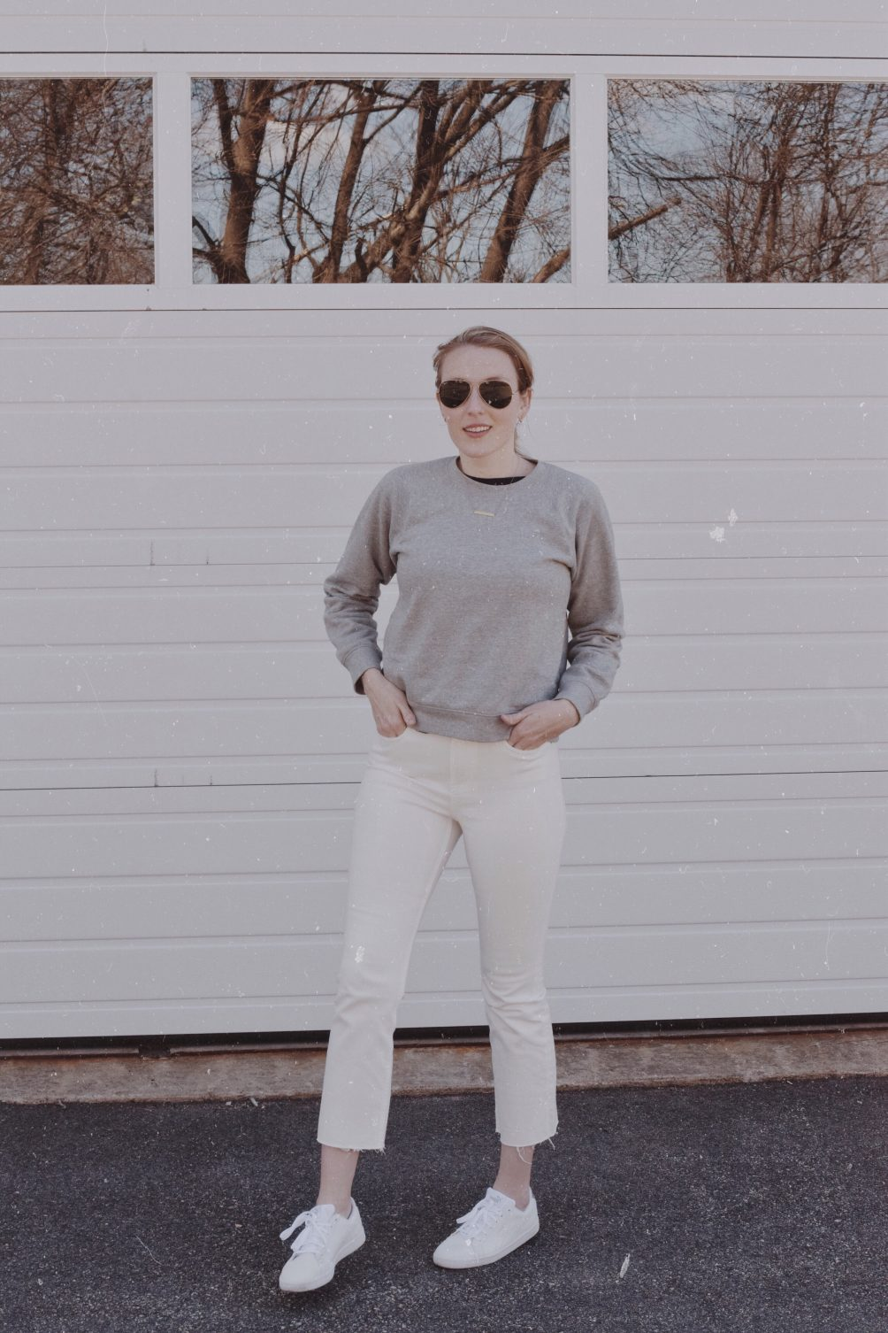 styling casual weekend neutrals for spring with Everlane jeans, crewneck sweatshirt, white sneakers, and aviators