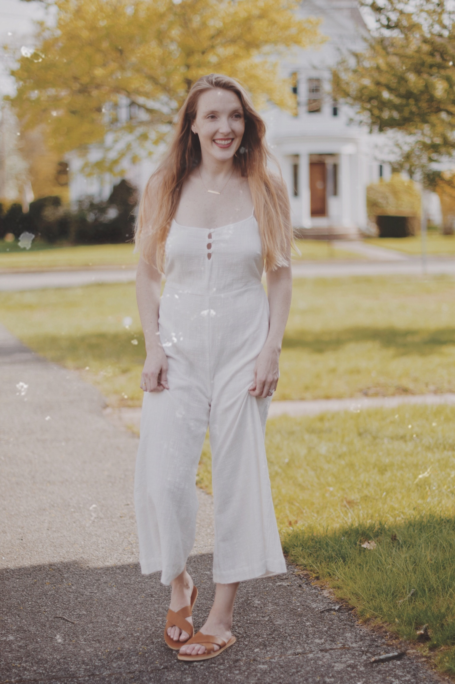 styling this white linen wide leg jumpsuit with leather crossover sandals from ethical fashion brand s Rowie the Label and Sseko