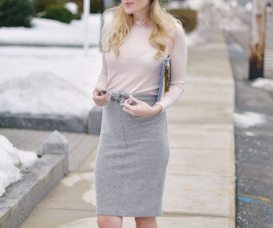 styling an embroidered collar sweater with tie waist skirt and burgundy loafers