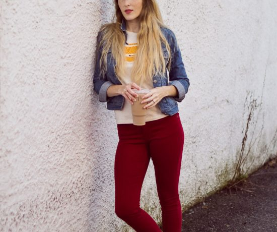 styling red skinny jeans for fall with a denim jacket and citron graphic tee